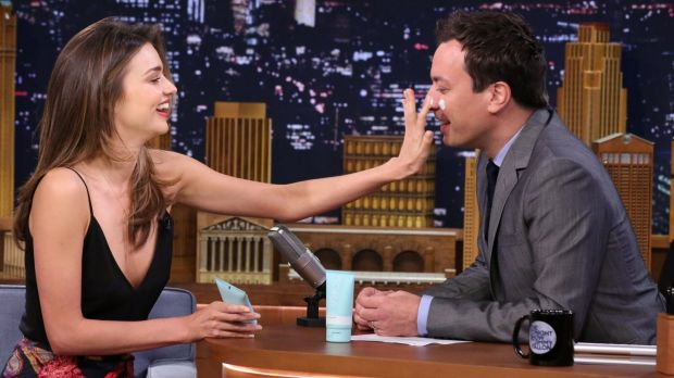 Miranda Kerr gives Jimmy Fallon a mini facial using her Kora Organics skincare products.