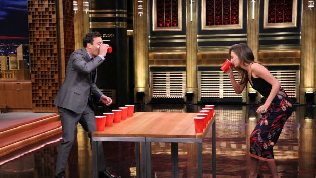 Jimmy Fallon and Miranda Kerr playing Flip Cup during her recent interview on The Tonight Show. Kerr lost in a ...