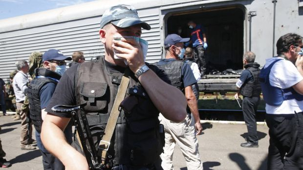 Pro-Russian rebels guard the train carrying bodies of MH17 victims.
