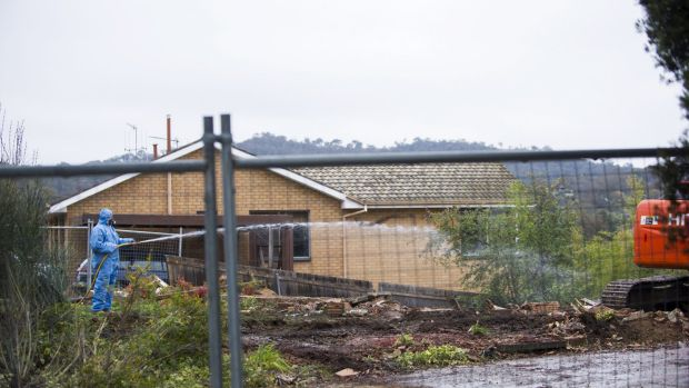 Gone: Workers demolish a Mr Fluffy home in Farrer.