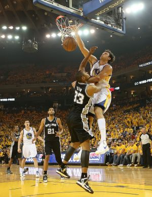 The air up there: Andrew Bogut dunks on Boris Diaw.