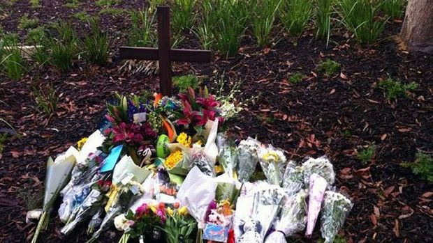 Tributes were placed at a cross erected at Scotch College today.