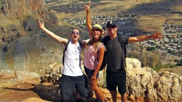 Max Steinberg (left) poses on a trip to Israel with his siblings Paige (centre) and Jake.