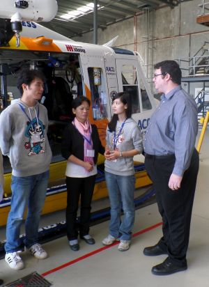 Che Yu, Linling's mother and Peng Linling visiting RACQ CQ Rescue, with federal MP George Chirstensen.