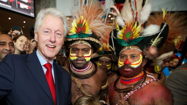 Former US president Bill Clinton poses with AIDS 2014 conference delegates from the Southern Highlands of Papua New Guinea.
