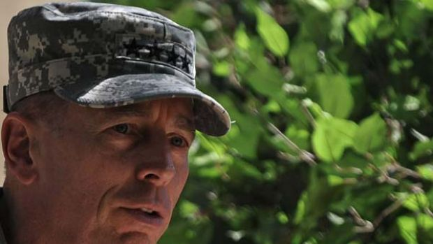Commander of NATO forces in Afghanistan US General David Petraeus speaks during a change of command ceremony at ISAF ...