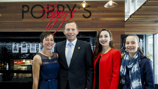 The opening of Poppy's cafe at the Australian War Memorial. Trooper David Pearce's daughters Hannah and Stephanie (red), ...
