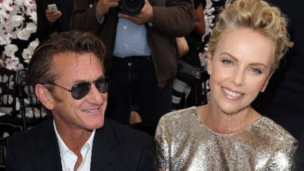 Sean Penn and Charlize Theron attend the Christian Dior show as part of Paris Fashion Week - Haute Couture Fall/Winter ...