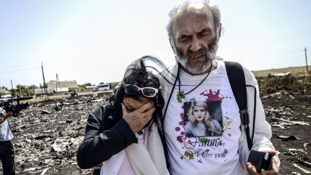 Perth couple George Dyczynski and Angela Rudhart-Dyczynski look over the wreckage of the crashed aircraft in Ukraine.