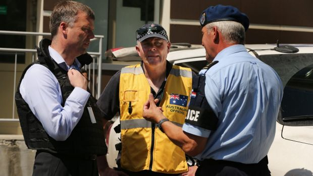 Deputy chief of the OSCE mission Alexander Hug, left, talks with members of the Australian contingent in Donetsk.