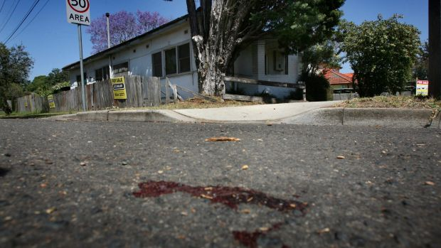 Blood stained the road after the van's theft.