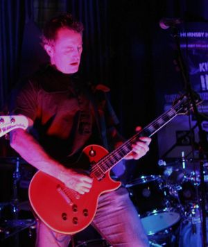 Damien Mahoney playing guitar.