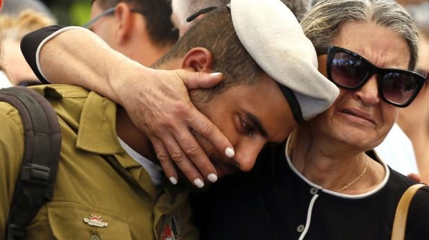 A comrade of 20-year-old Israeli army Staff Sergeant Amit Yeori mourns during his funeral at the Mount Herzl military ...