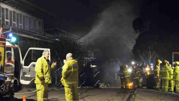 A building smoulders after firefighters attend a fire that broke out at Pembroke Secondary College in Mooroolbark this ...