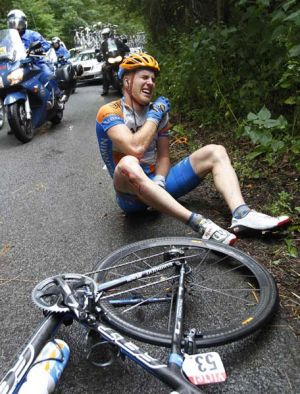 Tyler Farrar of the USA grimaces in pain after crashing.