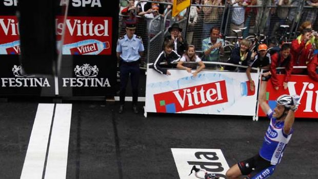 Quick Step rider Sylvain Chavanel of France celebrates as he crosses the finish line nearly four minutes ahead of the ...