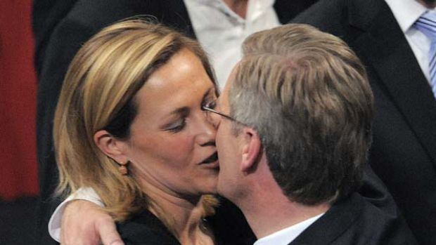 Germany's new President Christian Wulff, right, kisses his wife Bettina Wulff.