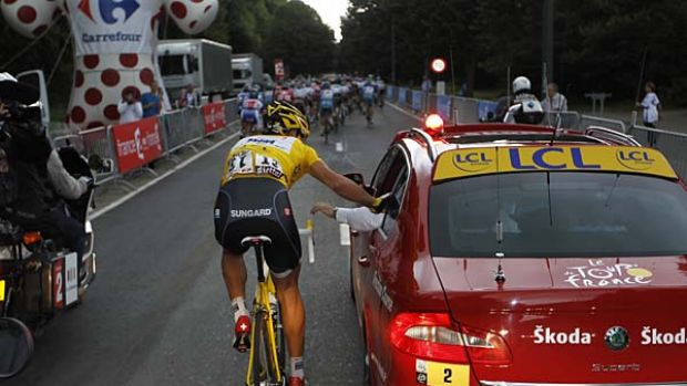 Race leader Fabian Cancellara of Switzerland talks to the race director informing him of the peloton's decision to slow ...
