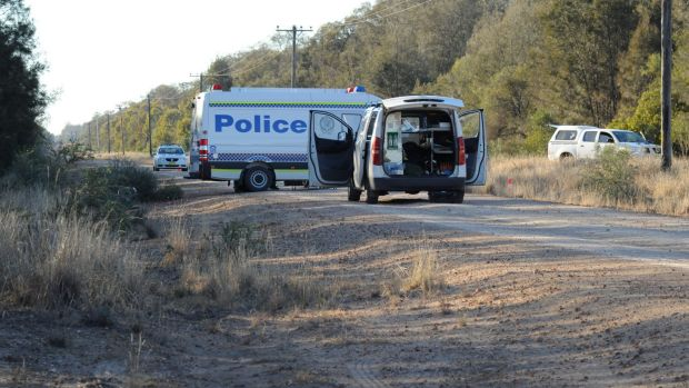 Police block off the road at Talga Lane on the Newell Highway at Croppa Creek, north of Moree, after Tuesday's fatal ...