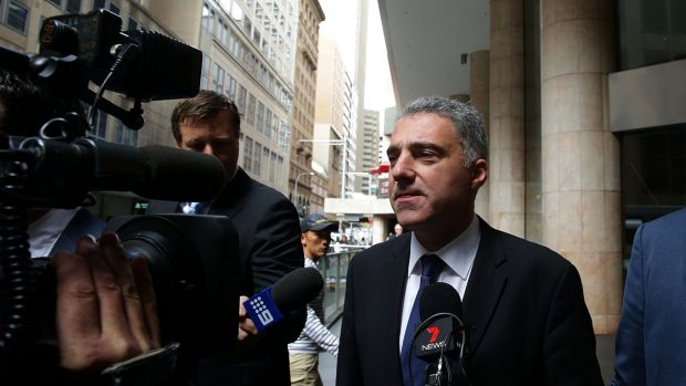 Paul Nicolaou leaves the ICAC hearings in April.