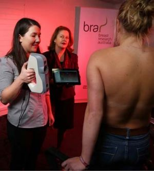 Phd student Celeste Coltman testing a participant's bra size as Dr Deirdre McGhee, Senior Lecturer Faculty of Science, ...