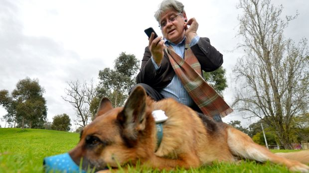 Clinical psychologist Leslie Posen, who uses quantifying apps,  with his dog Shrek, who also wears a GPS tracker.