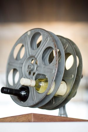 New farm cinemas 39 curtains open on new era for Movie reel wine rack
