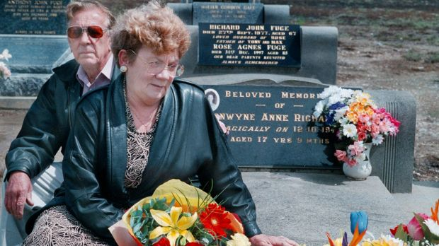 Distressed: Stan and Noelle Richardson visit their daughter Bronwynne's grave in 1998.