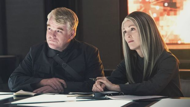 The Hunger Games June 3    Philip Seymour Hoffman as Plutarch Heavensbee and Julianne Moore as President Coin in <i>The ...