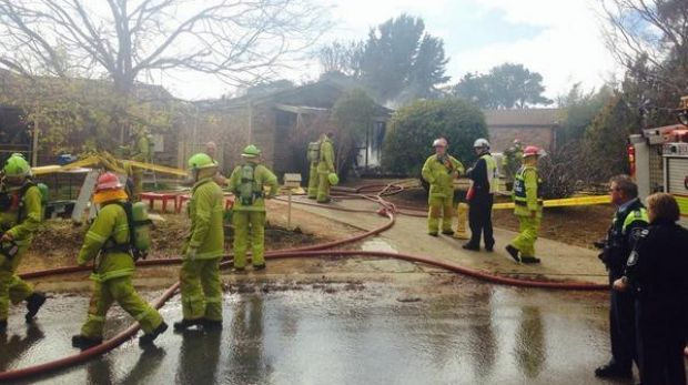 Firefighters at the scene of a McKellar house destroyed by fire